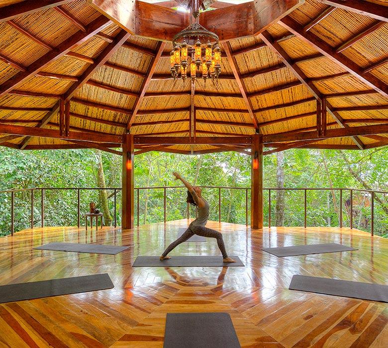 woman in yoga pavilion nayara springs